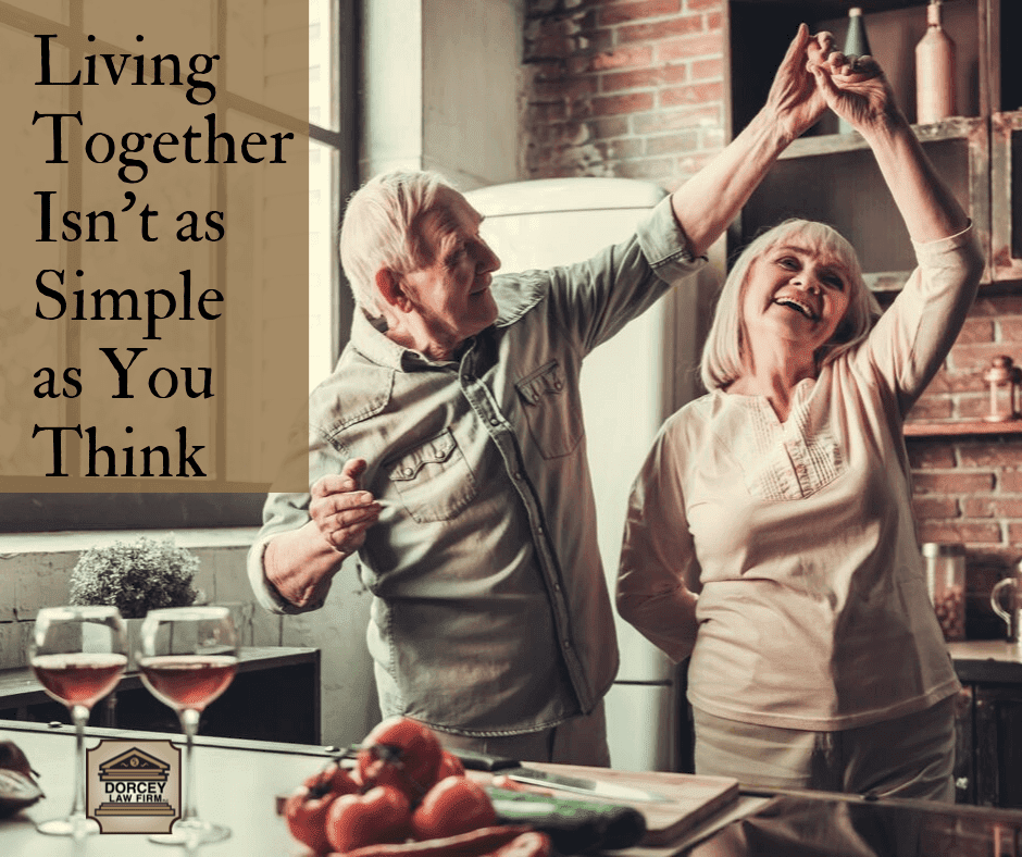 "couple dancing together in kitchen with caption text ""Living Together Isn't as Simple as You Think"""
